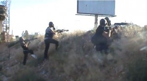 Syrian rebels fight with gas masks in Damascus.