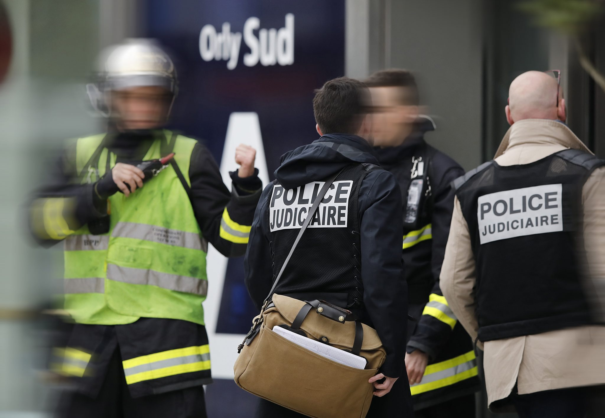 Judicial police investigators enter Orly airport southern terminal after shooting incident near Paris | REUTERS