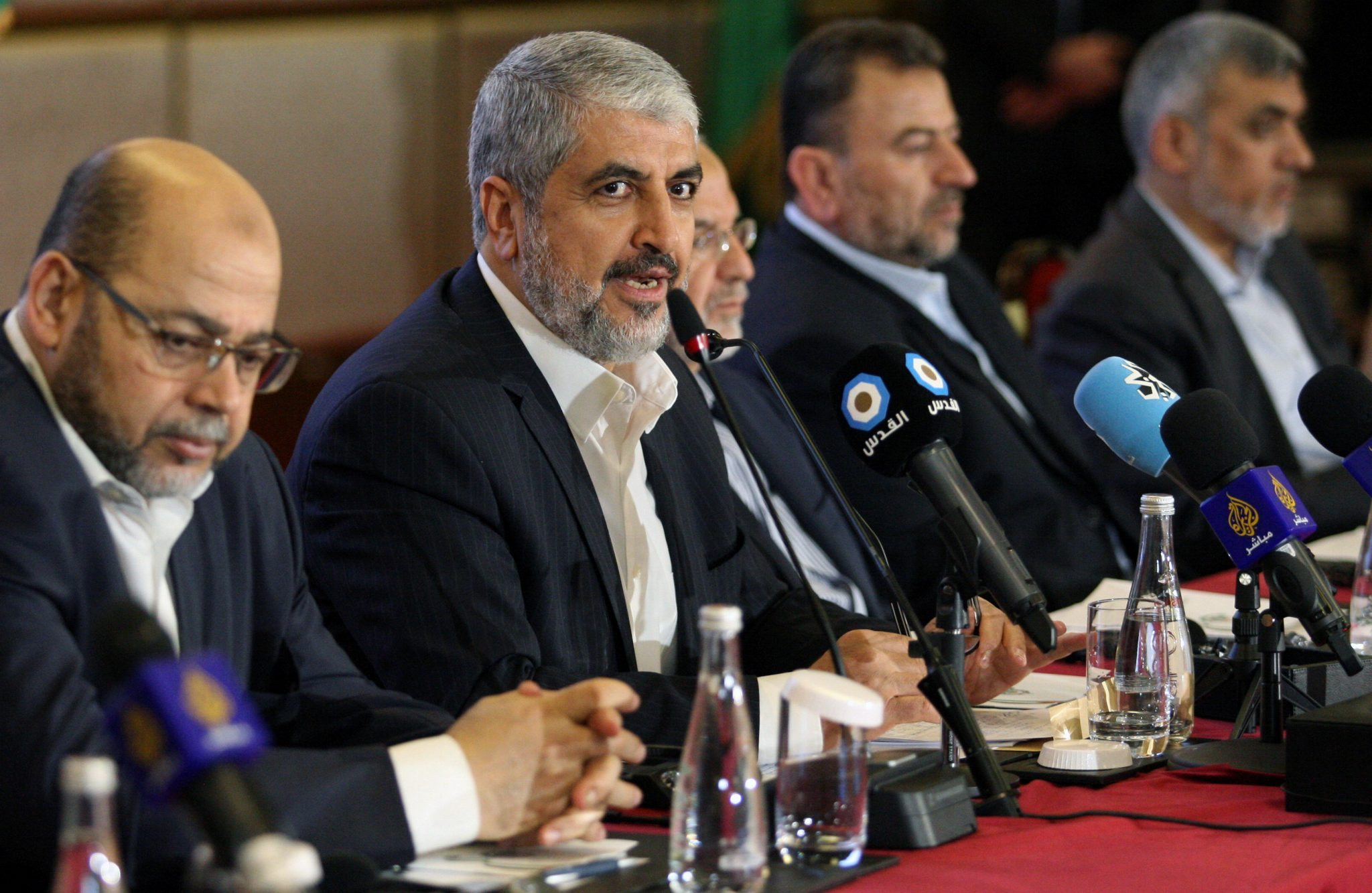 Hamas leader Khaled Meshaal gestures as he announces a new policy document in Doha | REUTERS