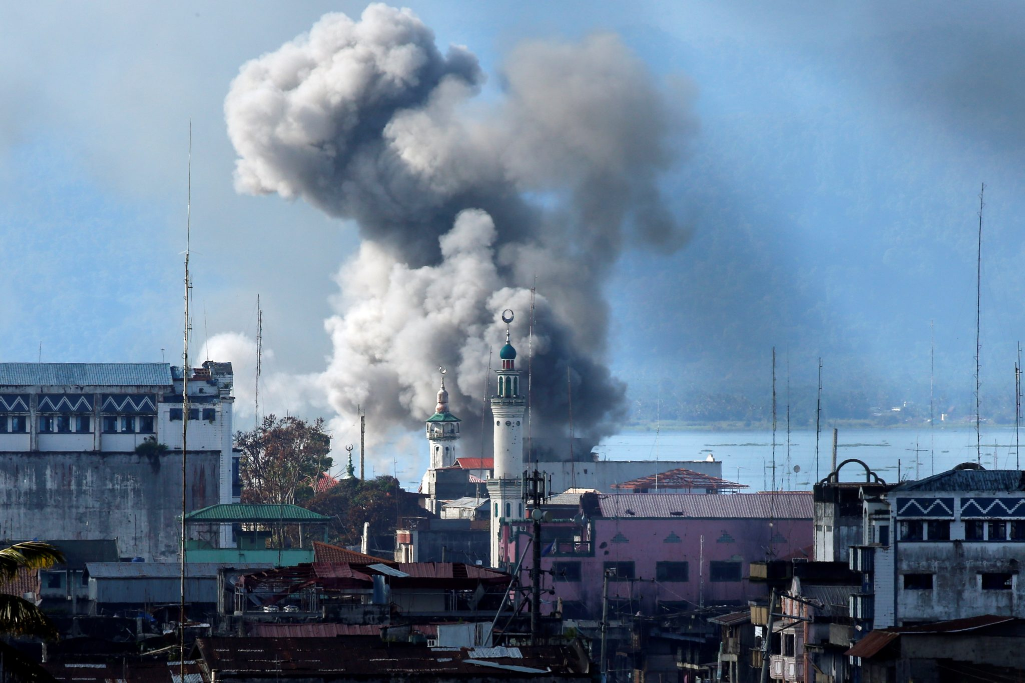 An explosion is seen after a Philippines army aircraft released a bomb during an airstrike in Marawi city | REUTERS