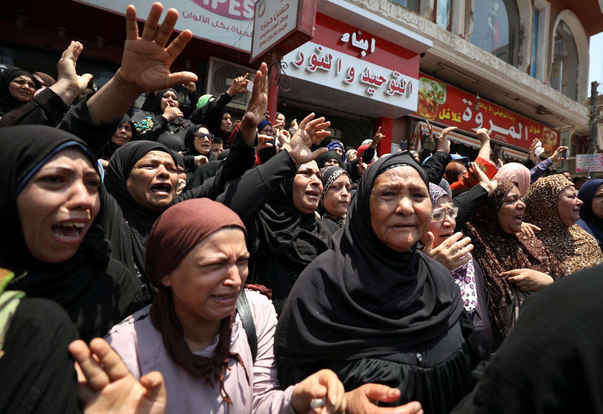 Egyptian relatives react during the funeral of officer Khaled al-Maghrabi, who was killed during a suicide bomb attack on an army checkpoint in Sinai, in his hometown Toukh, Al Qalyubia Governorate, north of Cairo | REUTERS