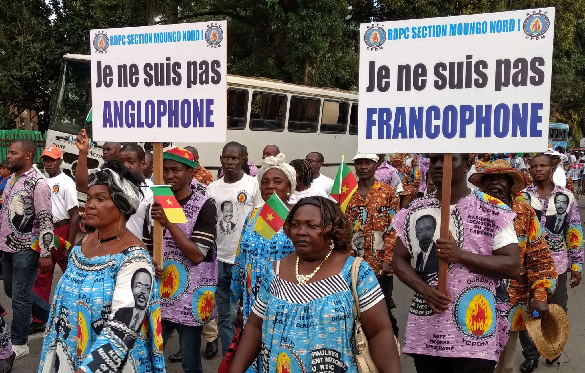 Demonstrators carry banners as they take part in a march voicing their opposition to independence or more autonomy for the Anglophone regions, in Douala | REUTERS