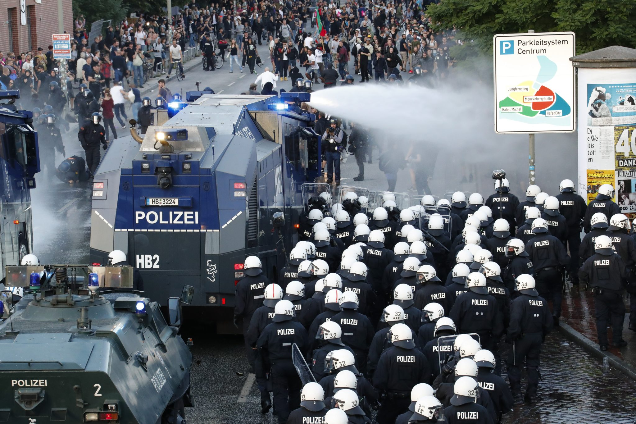 German riot police use water cannons against protesters during the demonstrations during the G20 summit in Hamburg | REUTERS