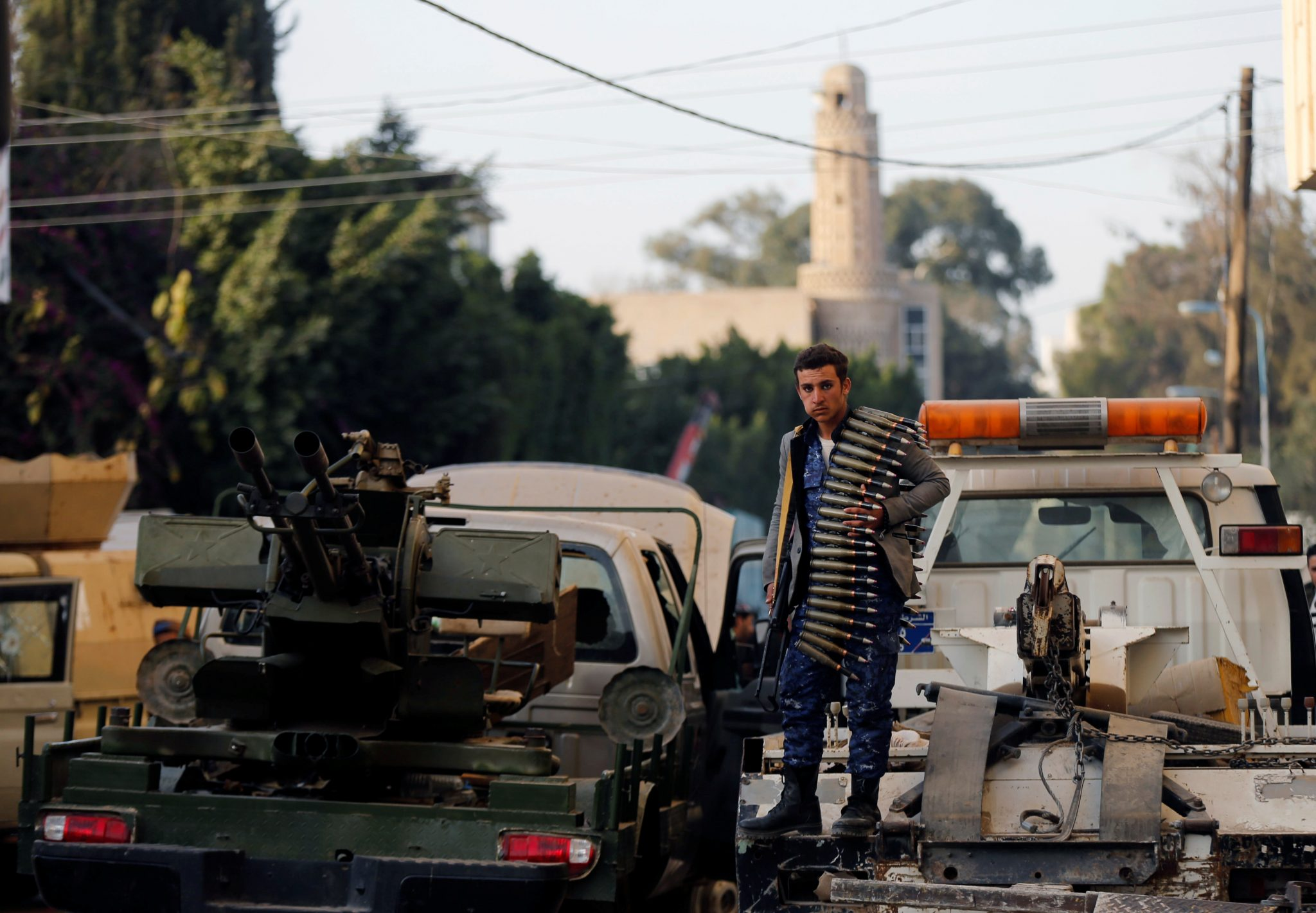 Houthis kill Saleh in Sanaa, Yemen: A Houthi fighter stands on a truck outside the house of Yemen's former president Ali Abdullah Saleh after Saleh was killed, in Sanaa | REUTERS