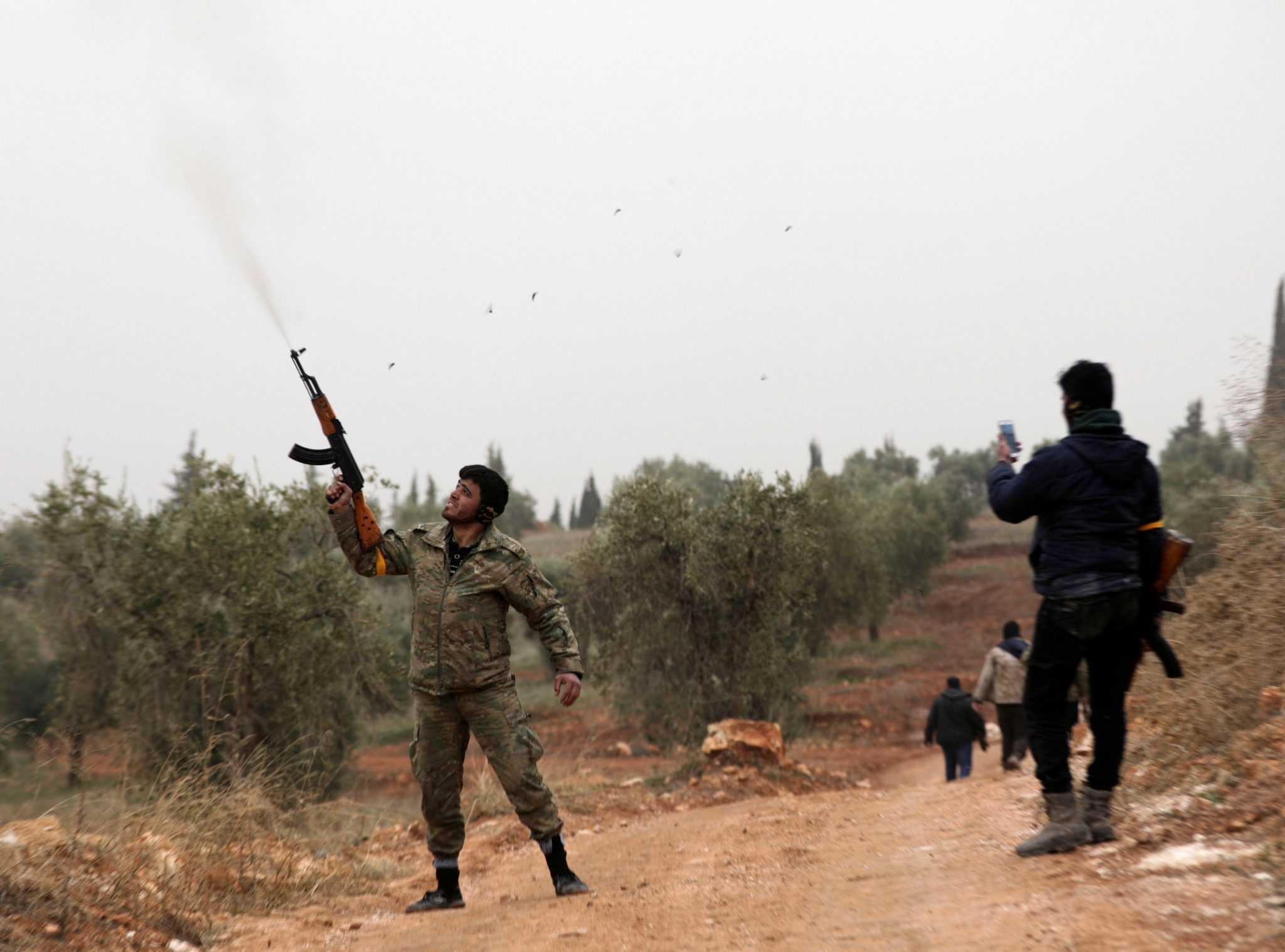 Turkish-backed Free Syrian Army fighters are seen near Mount Barsaya, northeast of Afrin | REUTERS