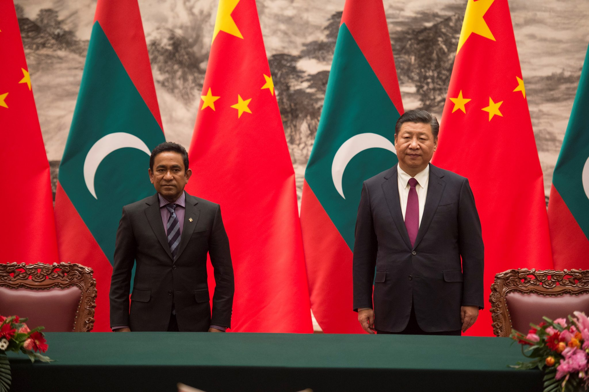 West becomes increasingly concerned with Yameen's close relationship with China: Maldives President Abdulla Yameen and China's President Xi Jinping attend a signing meeting at the Great Hall of the People in Beijing | REUTERS