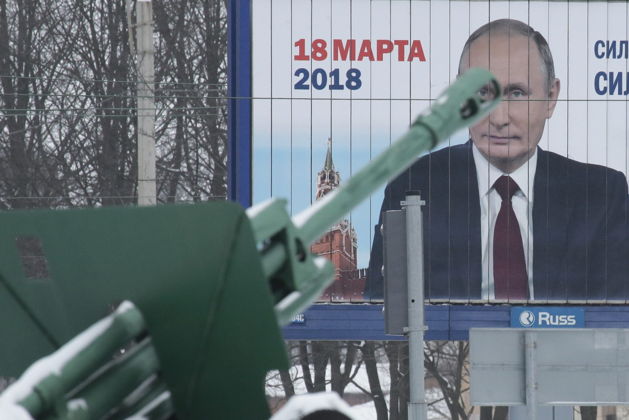 Russia to increase security following Dagestan militant attack, prior to elections: A historical Soviet artillery gun is seen in front of a board, which advertises the campaign of Russian President Putin ahead of the upcoming presidential election, at a World War Two memorial in St. Petersburg | REUTERS