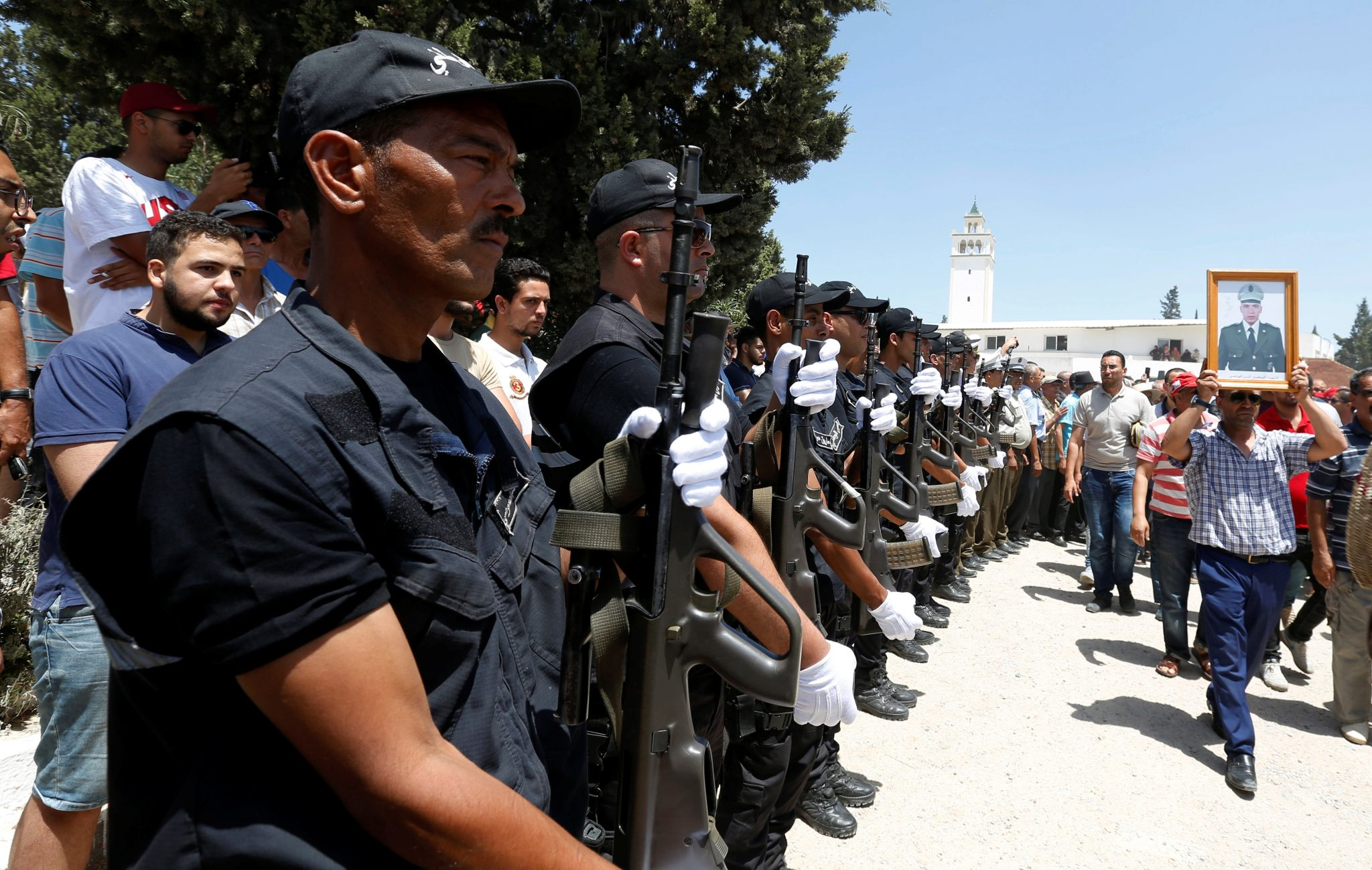 Police officers at attention in front the coffin of Anis El Werghi, a Tunisian security forces member, who was killed in an ambush in the northwest of the country, during his funeral in Tunis, Tunisia July 9, 2018 | REUTERS