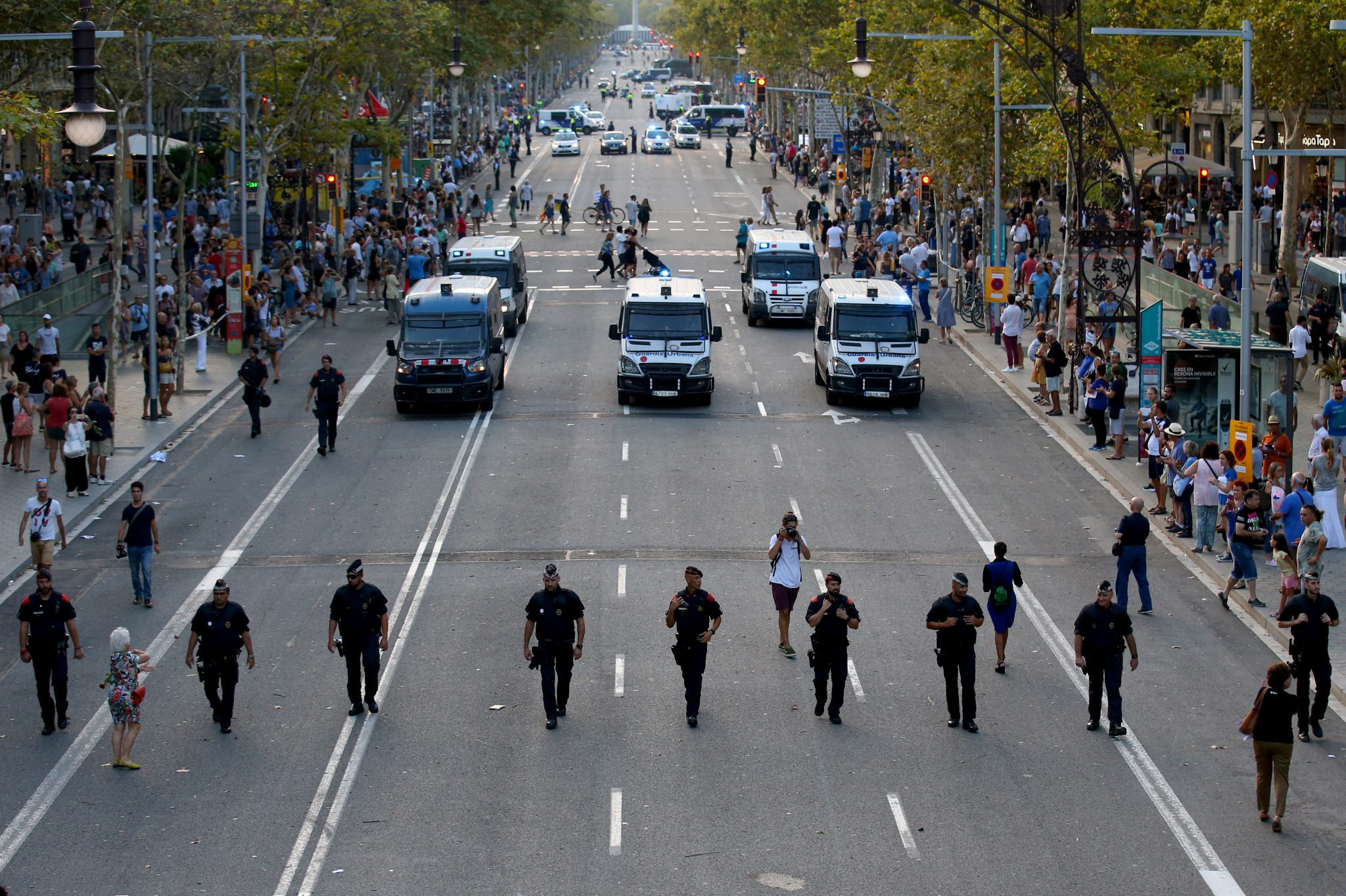 Barcelona stabbing, one year after La Rambla attack, underscores continuing link between psychological instability and militant style attacks: Catalan Mossos D'Esquadra officers patrol Paseo de Gracia street before a march of unity after the attacks in Barcelona, Spain, August 26, 2017 | REUTERS