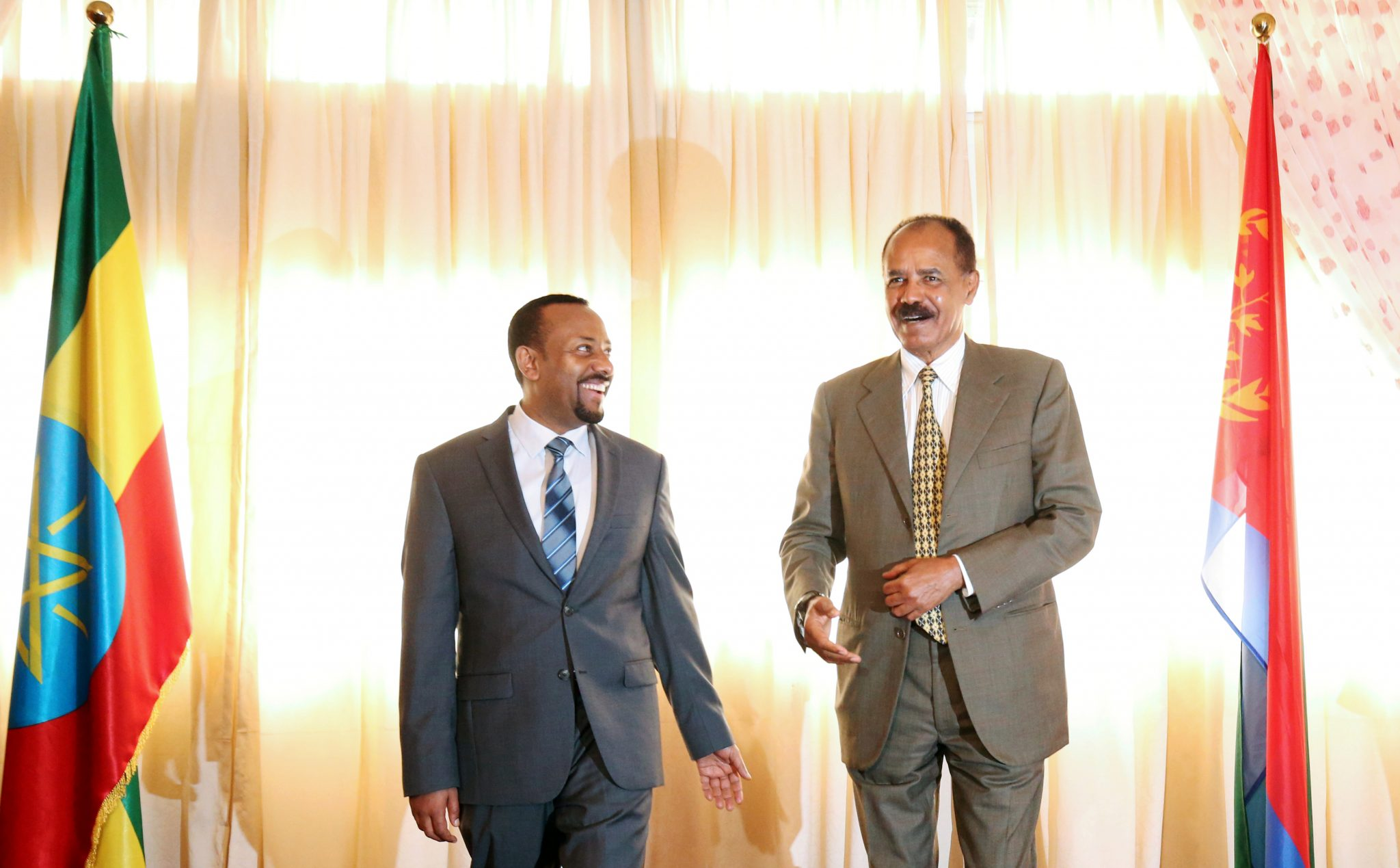 Eritrea's President, Isaias Afwerki talks to Ethiopia's Prime Minister, Abiy Ahmed during the Inauguration ceremony marking the reopening of the Eritrean Embassy in Addis Ababa, Ethiopia July 16, 2018. REUTERS/Tiksa Negeri - RC13F9FB50E0